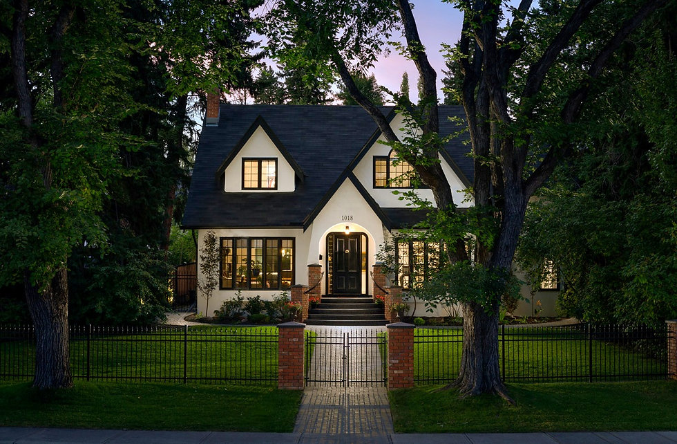 Beautiful traditional style modern home with large multi pane windows and black door