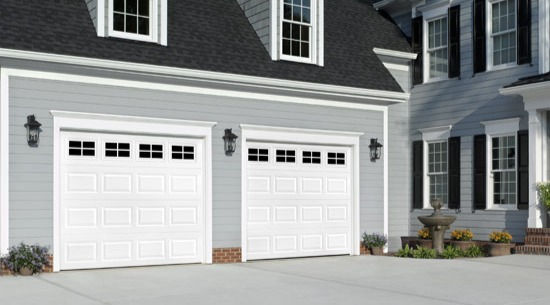 Modern grey home featuring white striking pannel designed tranditional doors. Available in steel.