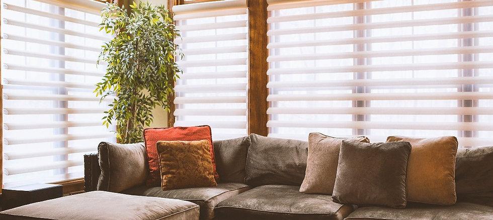 Elegant blinds and roller shades inside a modern living room