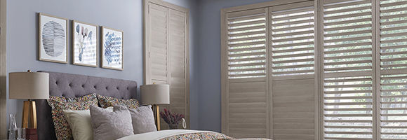 Bedroom with five large windows featuring 100% North American hardwood blinds in white.