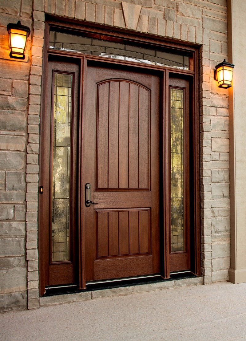 Dark stained solid wood door with side window glass features.