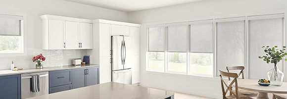 Kitchen with four large windows featuirng functional and aesthetic solar shades.