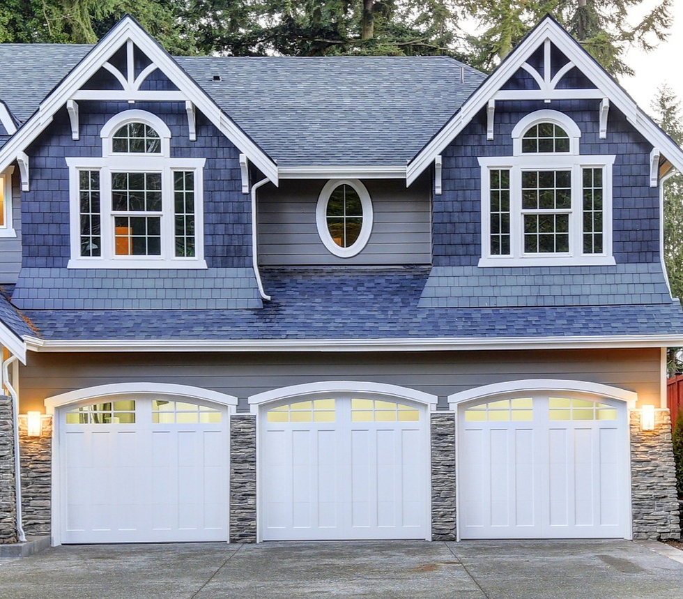 a modern home with three garage doors