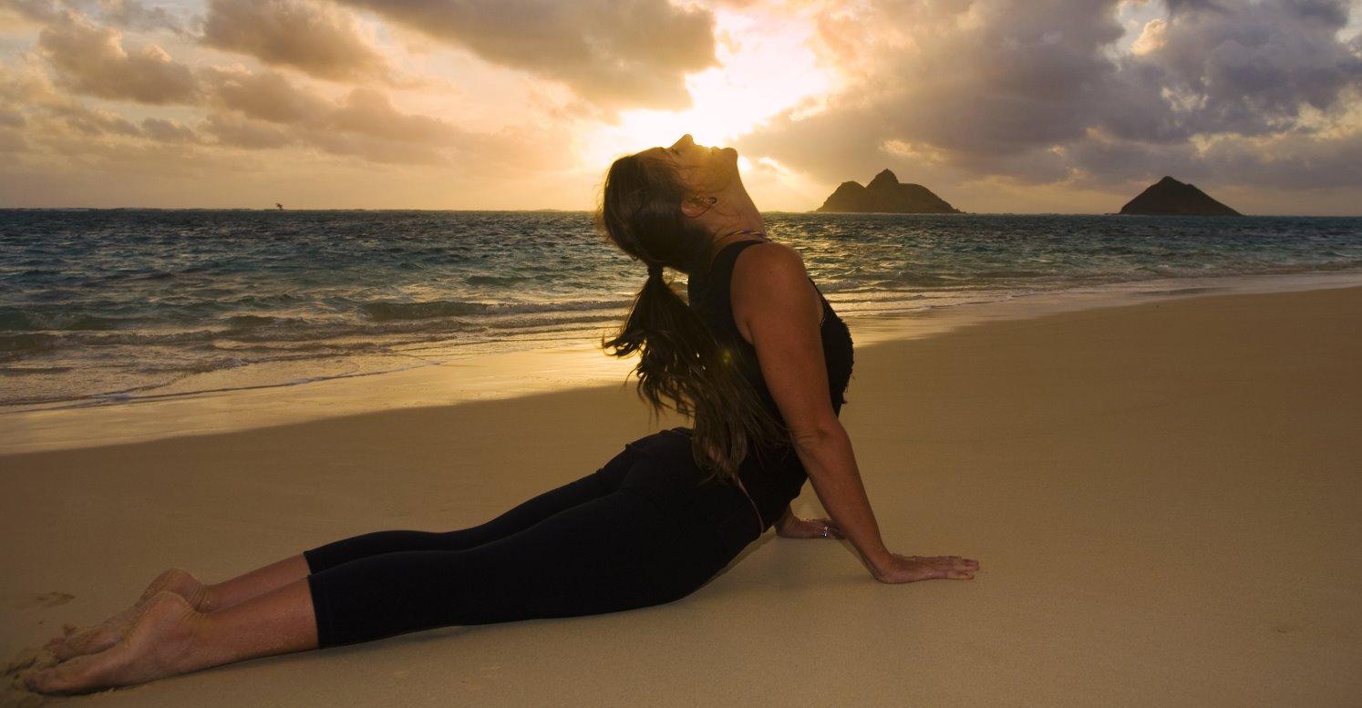 Ananda's Yoga teacher on the beach