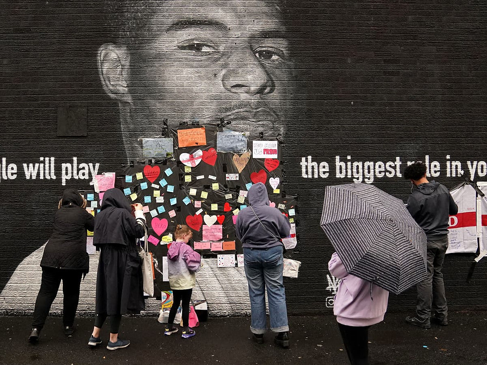Locals attach messages of support to Marcus Rashford mural after it was defaced with racial slurs