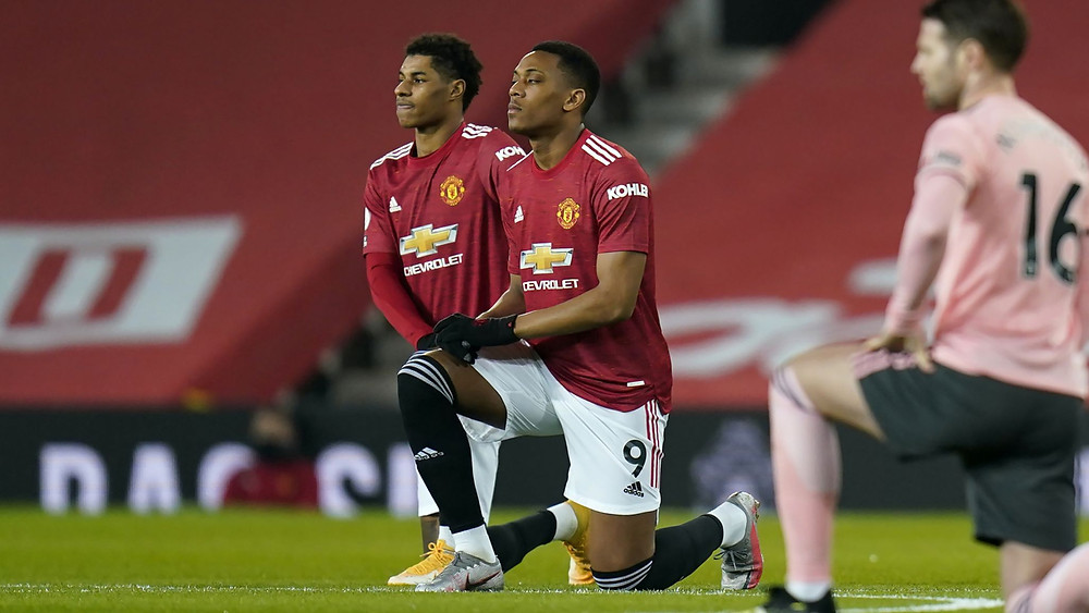 Premier League players take the knee in protest against racism