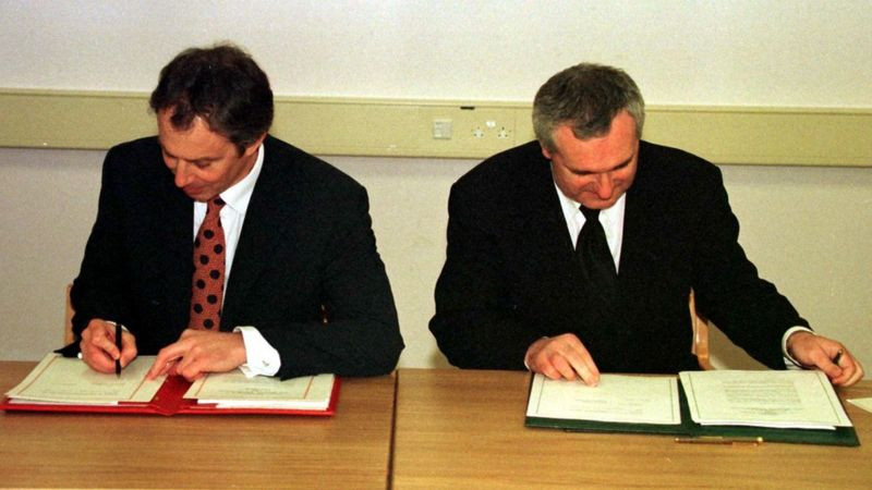 Tony Blair signing the Good Friday Agreement in Northern Ireland