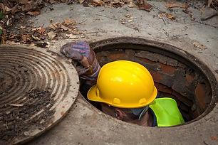 worker in manhole