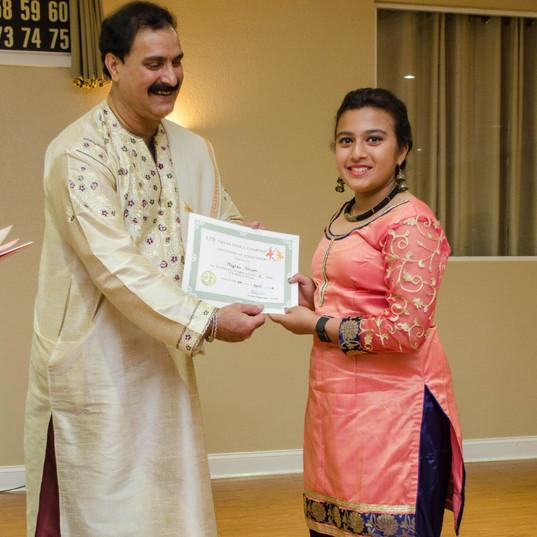 TirmiziJi presenting certificates to students