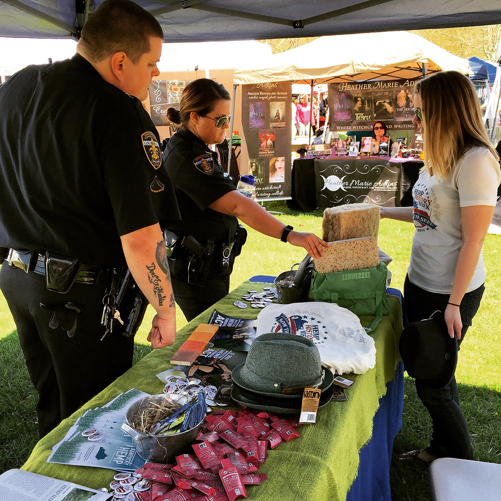 Kentucky Hempsters co-founder Kirstin Bohnert speaking to local law enforcement about hempcrete and hemp insulation at the Mighty Kindess Earth Day Hoot in Louisville on April 15, 2015.