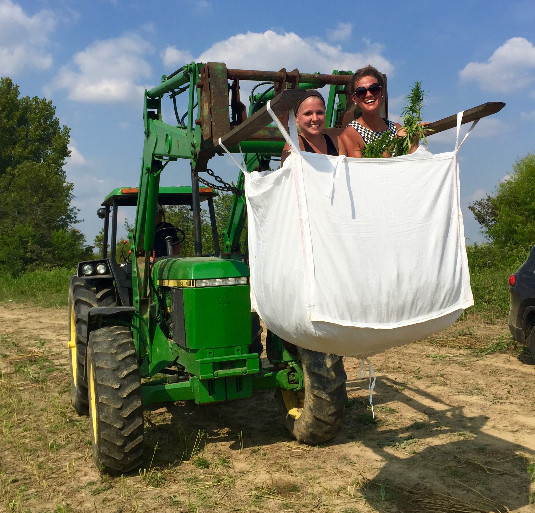Kentucky Hempsters co-founders Kirstin Bohnert and Alyssa Erickson load last sack of hemp from harvest into truck.