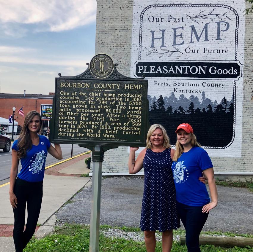 Heritage Hemp Trail co-founders, Alyssa Erickson and Kirstin Bohnert, with Pleasanton Goods owner Jennifer Tijou with the new Bourbon County Hemp marker.