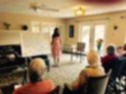 Photo of founder, Jaya Manjunah completing a crossword puzzle at Lansing Retirement