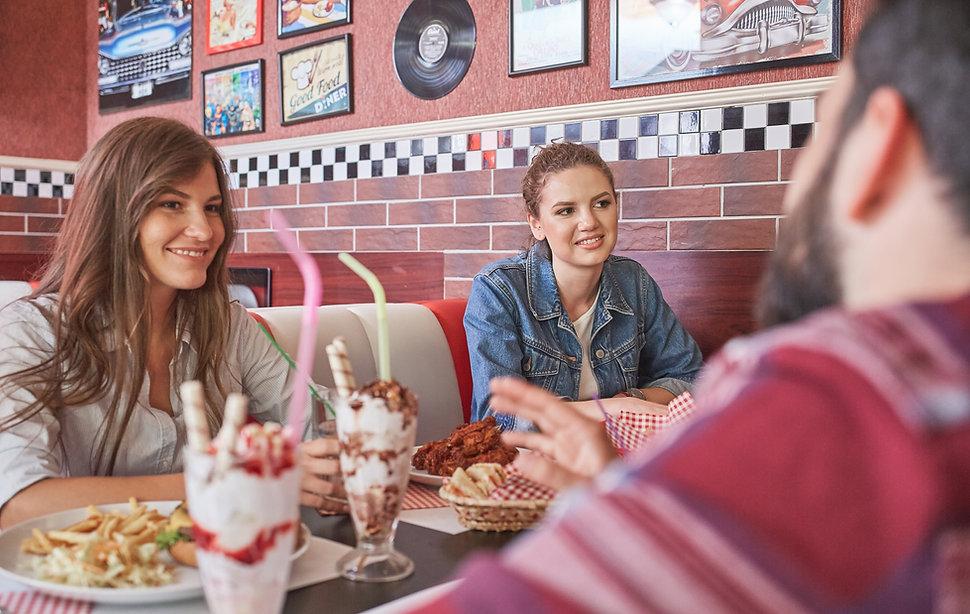 People eating food in restaurant.