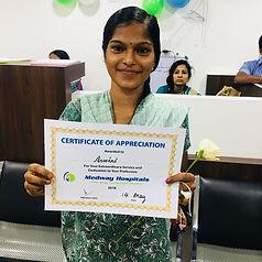 Aswini wins award from hospital.jpg