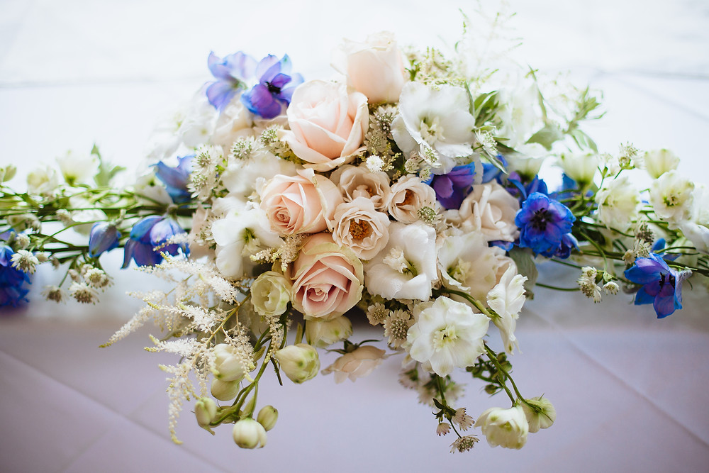 Long & low table arrangement - blush, white & blue.jpg