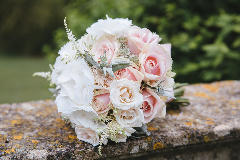 White & blush bouquet with soft green foliage.jpg