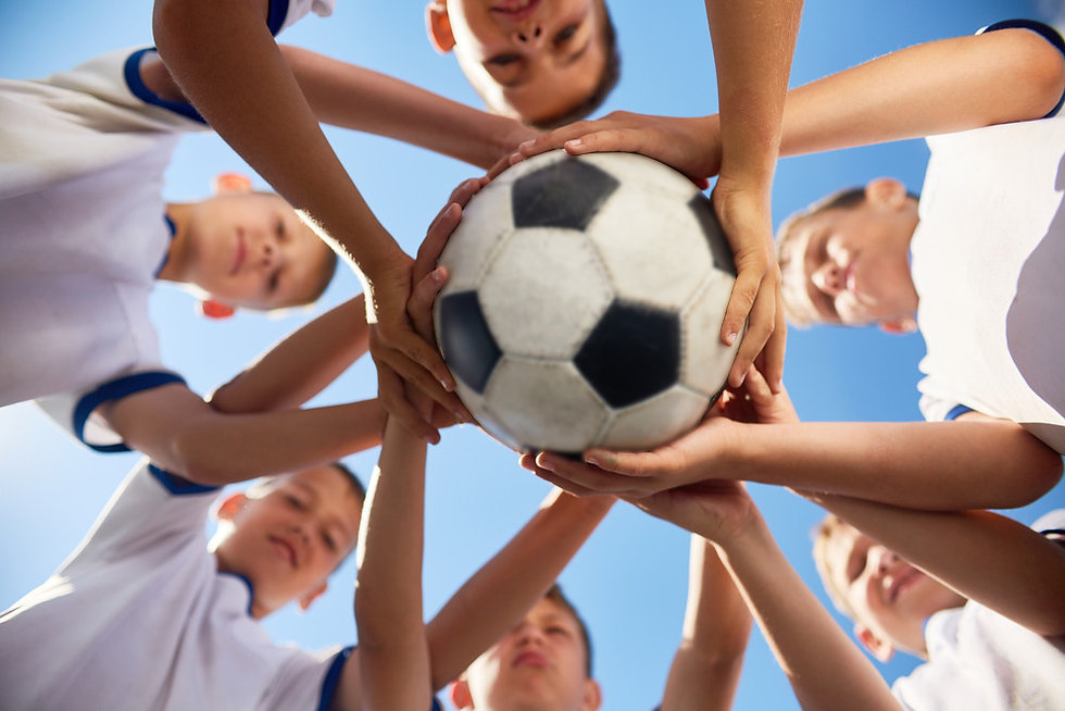 wsa kids holding soccer ball ghosted.jpg