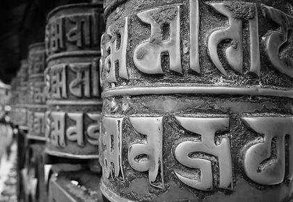 buddhist praying wheel 3479927_1280black and white.jpg