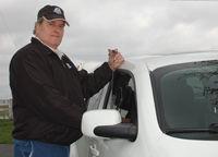 Locksmith unlocking car