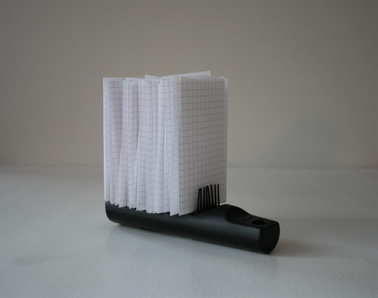 Hair brush and slips of squared paper (2020)