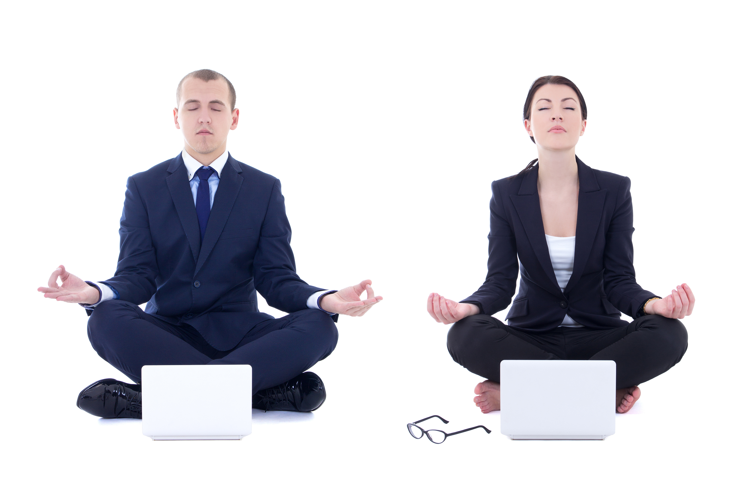 Young Business Man And Beautiful Business Woman Sitting In Yoga Pose With Laptops Isolated On White