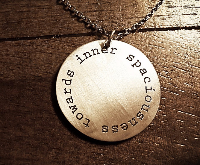 Towards Inner Spaciousness round pendant with chain