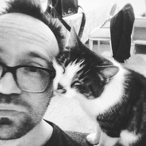 Voiceover artist David Wartnaby and Wicky, the studio cat