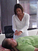 Receiving Reiki during a Wellness Session.