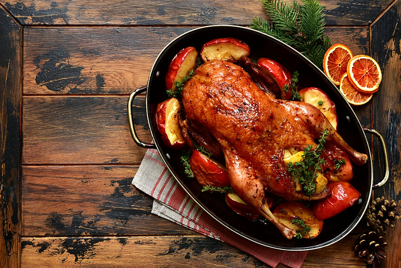 Roast goose stuffed with baked apples in