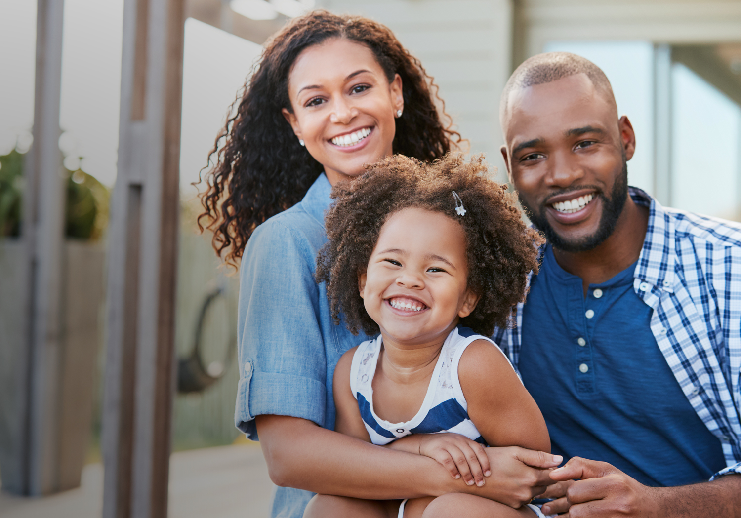 bigstock-Young-black-family-embracing-o-