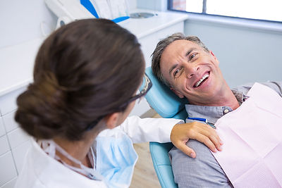 bigstock-Happy-patient-sitting-on-chair-