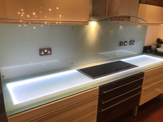 Light blue splashback with backlit worktop
