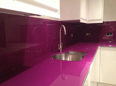 Aubergine worktop and splashbacks