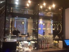 Behind bar glass