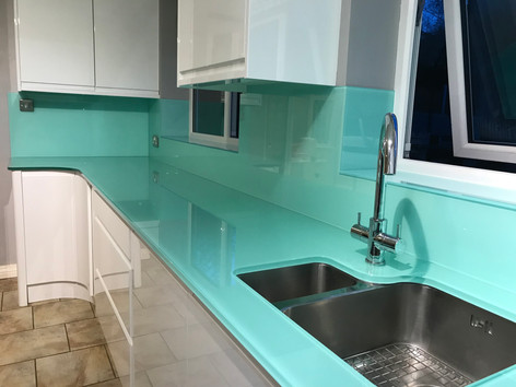 Blue splashbacks, worktops and window sils