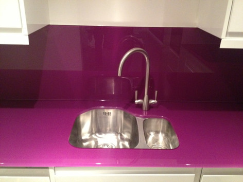 Purple worktop and splashbacks