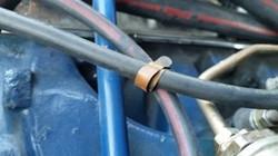 Original brass strap for vacuum hoses