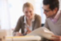 Woman and man organizational consultants meeting and reviewing HR organizational documents
