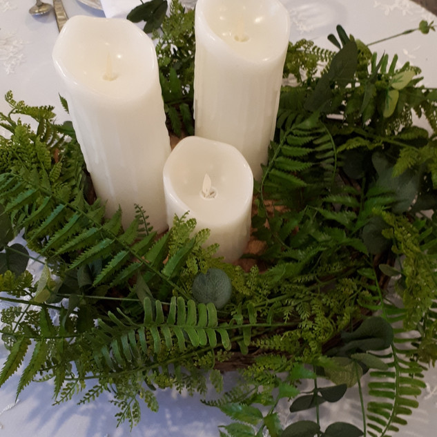 Faux greenery centrepiece