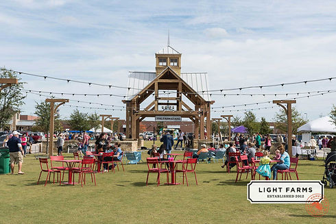 families-at-outdoor-dining-tables-at-Lig