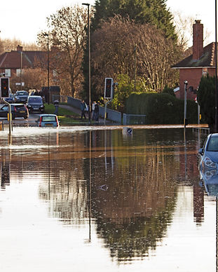 A flooded road junction with a drowned car.jpg