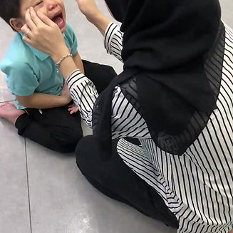Teacher Yaya practicing Skull Tapping/Magic Massage on a Kidana Child