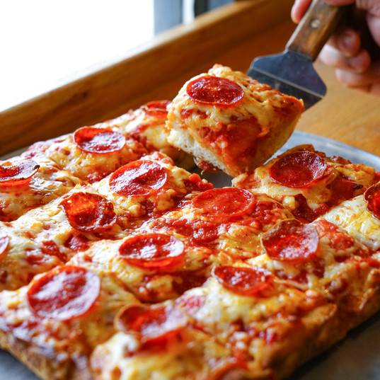 We serve Sicilian style pizza to satisfy all your cravings!