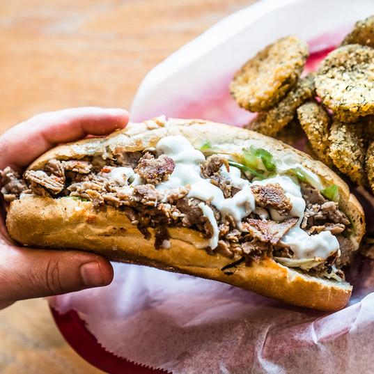 A philly cheesesteak and deep-fried pickles: the perfect pair.