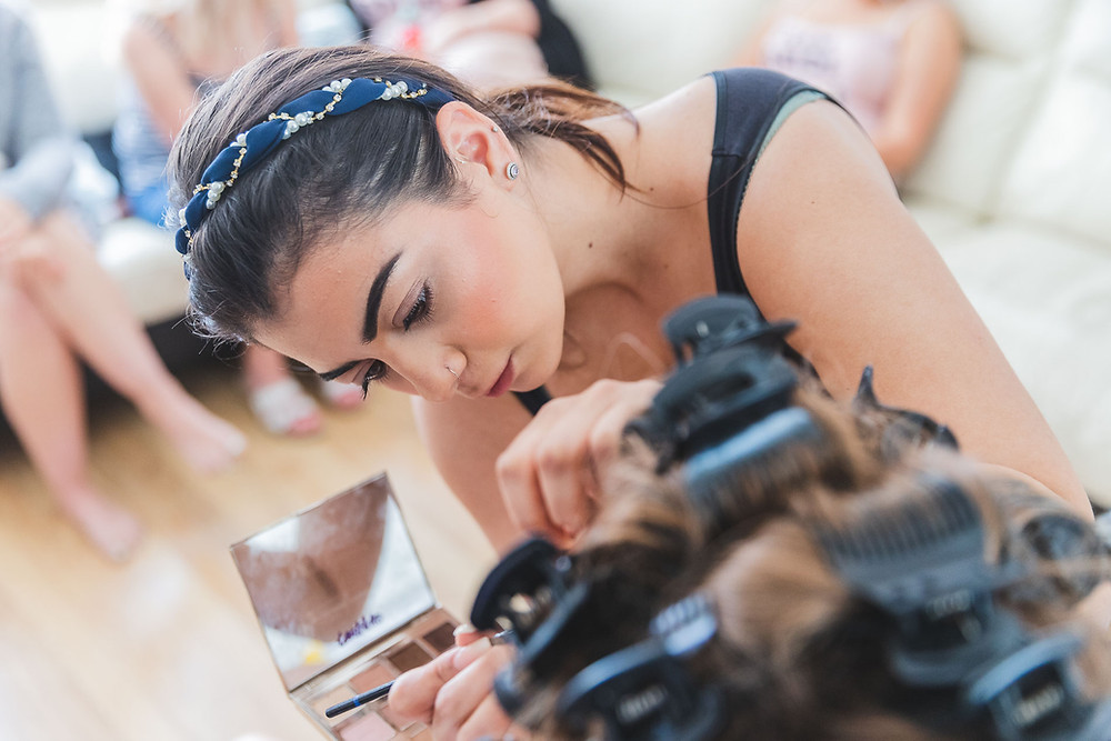 MUA Olivia Demetriou getting the bride and bridesmaids ready for the big day