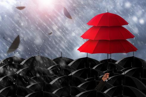 Insurance agent holding red umbrella thr