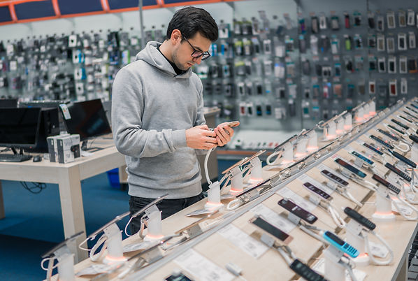 Smart customer choosing smartphone in the mobile phone shop. difficult decision. Various c