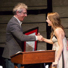 Selection Committee Member Eric Bogosian presents Clare Barron with the 2015 Relentless Award for her script, Dance Nation