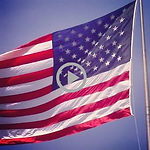 square ghosted US flag with video arrow.